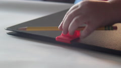 A student snaps his pencil to his education textbook notebook. Stock Footage