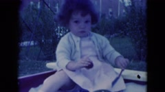 1949: spoiled young toddler girl playing sandbox MIDDLETOWN Stock Footage
