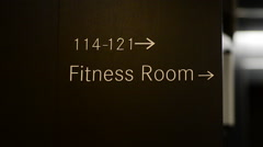 Sign for Fitness Room at a modern hotel. Stock Footage