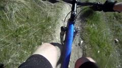 POV of a man mountain biking on a dirt trail. Stock Footage