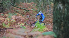 Close-up detail of a man mountain biking on a singletrack dirt trail. Stock Footage