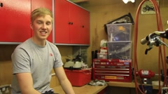 Portrait interview of a man in a workshop. Stock Footage