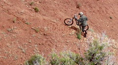 A mountain biker riding on a singletrack trail. Stock Footage