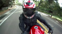 POV of a man riding a red motorcycle. Stock Footage