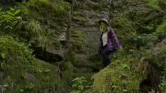 Women Hikers Climb Down Steep Trail In Lush Green Forest Stock Footage