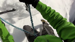 POV of mountain climbing in the snow using crampons and ice axes. Stock Footage