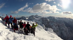 Group portrait of mountain climbers in the snow using crampons and ice axes. Stock Footage