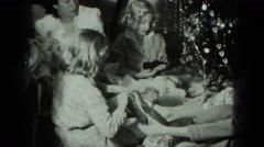 1949: caucasian family ravenously opening xmas gifts VENICE, ITALY Stock Footage