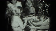 1949: caucasian family ravenously opening xmas gifts VENICE, ITALY Stock Footage
