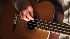 A young man plays his bass guitar. Stock Footage