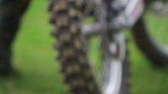 Extreme close-up detail of motocross motorcycle wheels. Stock Footage