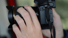 POV close-up of a photographer pointing his camera towards the viewer. Stock Footage