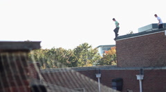 A young man doing a parkour freerunning jumping stunt. Stock Footage