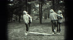 1949: girls out in the woods playing on teeter totter VENICE, ITALY Stock Footage