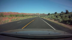 POV time-lapse of a car driving on a desert road. Stock Footage