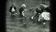 1949: feeding pigeons in the park VENICE, ITALY Stock Footage