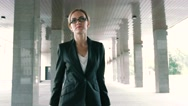 Close-up of a confident blond businesswoman walking with trolley Stock Footage