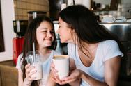 Mother and daughter drink espresso Stock Photos