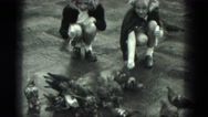 1949: girls in city feeding pigeons VENICE, ITALY Stock Footage