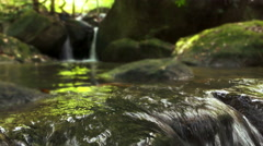 Close up of natural water fall with rock Stock Footage