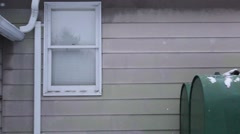 A detail of a house in winter while it is snowing. Stock Footage