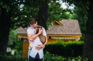Young adult brunette man and woman in the park Stock Photos
