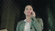 Young concentrated businesswoman doing business on the phone Stock Footage