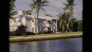 1951: boat ride through huge mansions and beautiful homes FLORIDA Stock Footage