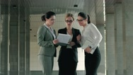 Three beautiful professionals discussing their working day Stock Footage
