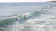 Surfers carving a wave. Stock Footage