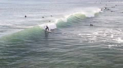 Surfer catching a wave and riding it. Stock Footage
