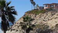 Panning shot of Solana beach with cliffside house. Stock Footage