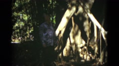 1951: an older man looks lost in the forest FLORIDA Stock Footage