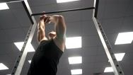 The athlete pulls on the bar at the gym Stock Footage