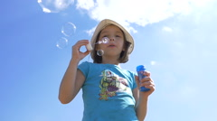 Girl Blowing Soap Bubbles Outdoors On A Sky Background, Slow Motion Stock Footage