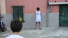Boys playing soccer / football in Porto Venere, Liguria, Italy Stock Footage