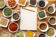 Various spices and blank notebook. Stock Photos
