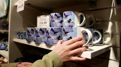 People buying mug inside Vancouver aquarium gift shop. Stock Footage