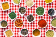 Various dried herbs and spices in bowl. Stock Photos
