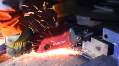 Men cutting the stopper with maktec grinder Stock Footage