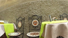 Cafe tables and chairs in the village of Monterosso al Mare in the Cinque Terre Stock Footage