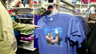 People buying Vancouver aquarium logo T-shirt inside gift shop. Stock Footage