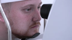 Scanning the retina, eye test. Special contemporary ophthalmic device Stock Footage