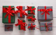 Top view of christmas present boxes on white wood background Stock Photos