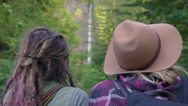 Hikers Rest And Enjoy View Of Waterfall From A Distance Stock Footage
