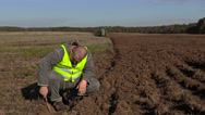 Farmer inspect to the plowing ground depth Stock Footage