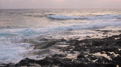 Waves breaking against rocks on sea shoreline. Stock Footage