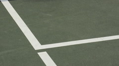 Extreme closeup detail of a tennis ball hitting the corner of the court. Stock Footage