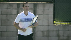 Close-up of a male tennis player hitting the ball with his racquet. Stock Footage