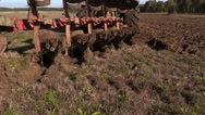 Tractor start plowing field on the edge Stock Footage